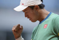Japan's Kei Nishikori reacts as he wins a point against Russia's Karen Khachanov during their second round match on day four of the French Open tennis tournament at Roland Garros in Paris, France, Wednesday, June 2, 2021. (AP Photo/Thibault Camus)