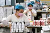 SUIXI, CHINA - MARCH 23 2020: Workers pack medical gloves at a manufacturer of medical supplies in Suixi county in central China's Anhui province Monday, March 23, 2020.- PHOTOGRAPH BY Feature China / Barcroft Studios / Future Publishing (Photo credit should read Feature China/Barcroft Media via Getty Images)