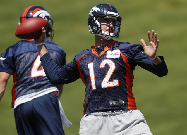Denver Broncos quarterback Paxton Lynch throws a pass during drills at the NFL football team's training camp Wednesday, June 13, 2018, in Englewood, Colo. (AP Photo/David Zalubowski)