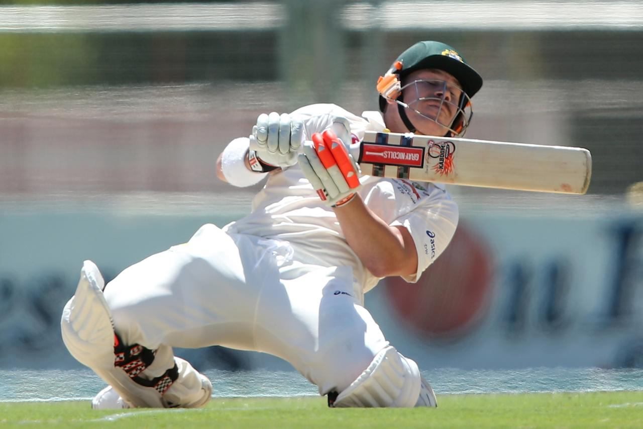 ADELAIDE, AUSTRALIA - NOVEMBER 22: David Warner of Australia ducks under a high ball during day one of the 2nd Test match between Australia and South Africa at Adelaide Oval on November 22, 2012 in Adelaide, Australia.  (Photo by Morne de Klerk/Getty Images)