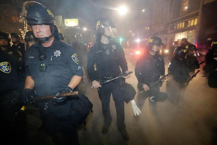 <p>Police make a line to prevent protesters from marching Wednesday, Nov. 9, 2016, in Oakland, Calif. Police in Oakland blocked thousands of people protesting Donald Trump's election from getting onto a highway Wednesday night. The crowd chanting and waving signs gathered in Frank Ogawa Plaza in downtown Oakland in the afternoon. (Photo: Marcio Jose Sanchez/AP) </p>