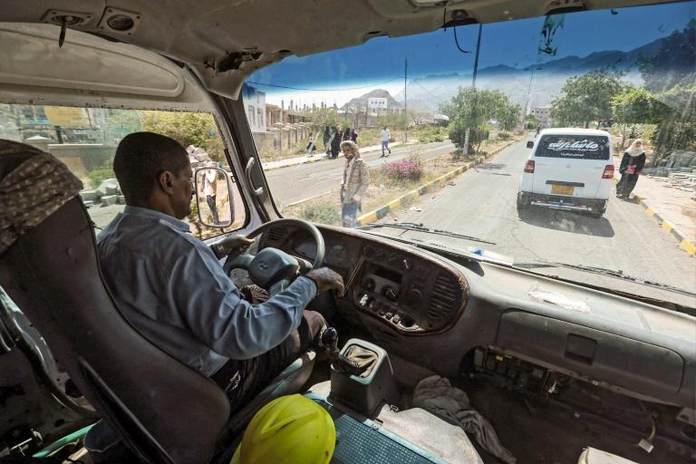 A man drives a university bus transformed into a water tanker in Yemen's third city of Taiz on September 21, 2019 (AFP Photo/AHMAD AL-BASHA)