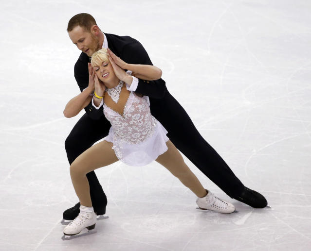 Caydee Denney and John Coughlin compete during the pairs free skate at the U.S. Figure Skating Championships in Boston, Saturday, Jan. 11, 2014. (AP Photo/Elise Amendola)