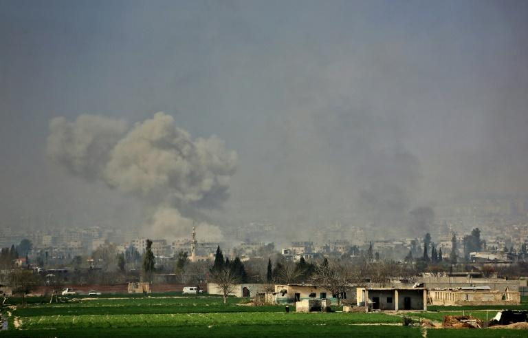 Smoke rises after Syrian regime strikes on the village of Mesraba in Eastern Ghouta on March 7, 2018