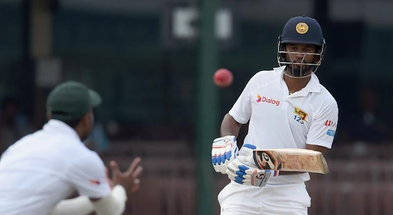 Sri Lanka's opener Dimuth Karunaratne (right) plays a shot on the fourth day of their second Test against Bangladesh in Colombo, on March 18, 2017 (AFP Photo/Ishara S. Kodikara)