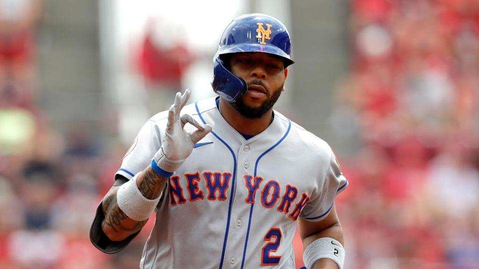 Dominic Smith gestures toward Mets bench after hitting grand slam
