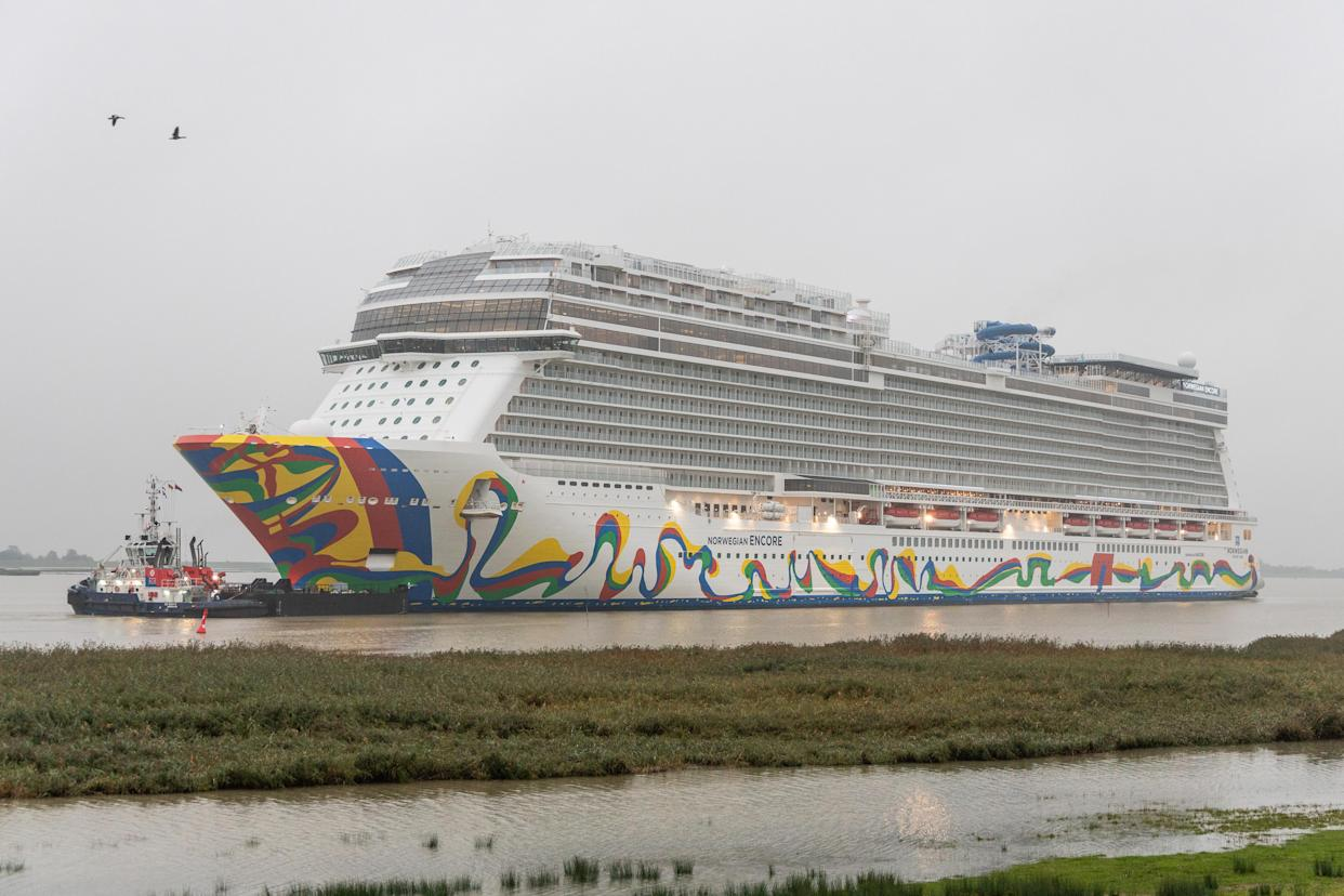 """The """"Norwegian Encore"""" as the newest cruise giant of the Meyer shipyard in Papenburg is being transported slowly backwards, pulled by tugs, on the Ems into the North Sea. The ship has room for 4,000 passengers. (Photo by Martin Remmers/picture alliance via Getty Images)"""