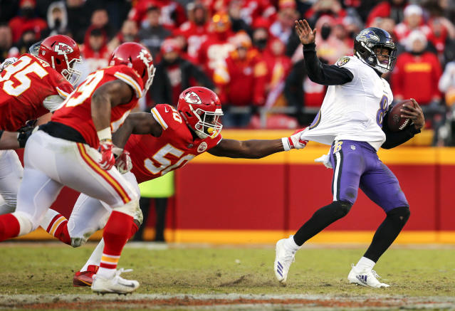<p>Justin Houston #50 of the Kansas City Chiefs pulled the jersey of quarterback Lamar Jackson #8 of the Baltimore Ravens in overtime at Arrowhead Stadium on December 9, 2018 in Kansas City, Missouri. The Chiefs beat the Ravens, 27-24. (Photo by David Eulitt/Getty Images) </p>