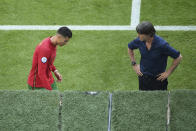 Germany's manager Joachim Loew, right, looks to Portugal's Cristiano Ronaldo during the Euro 2020 soccer championship group F match between Portugal and Germany at the football arena stadium in Munich, Saturday, June 19, 2021. (Matthias Hangst/Pool Photo via AP)