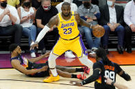 Los Angeles Lakers forward LeBron James (23) is fouled by Phoenix Suns forward Mikal Bridges during the first half of Game 5 of an NBA basketball first-round playoff series, Tuesday, June 1, 2021, in Phoenix. (AP Photo/Matt York)