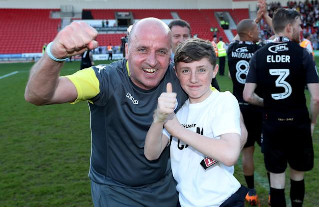 """Soccer Football - League One - Doncaster Rovers vs Wigan Athletic - Keepmoat Stadium, Doncaster, Britain - May 5, 2018 Wigan Athletic manager Paul Cook celebrates after winning League One Action Images/John Clifton EDITORIAL USE ONLY. No use with unauthorized audio, video, data, fixture lists, club/league logos or """"live"""" services. Online in-match use limited to 75 images, no video emulation. No use in betting, games or single club/league/player publications. Please contact your account representative for further details."""