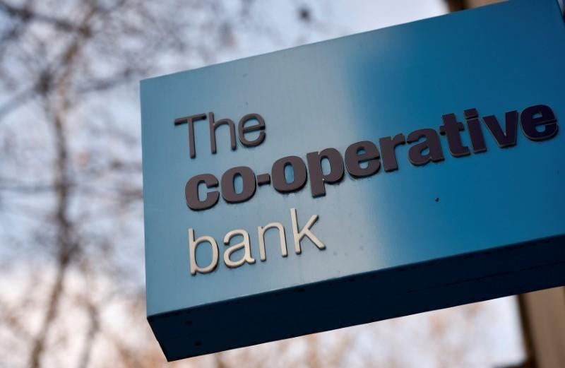 FILE PHOTO: A sign hangs outside of a branch of The Co-operative Bank in London
