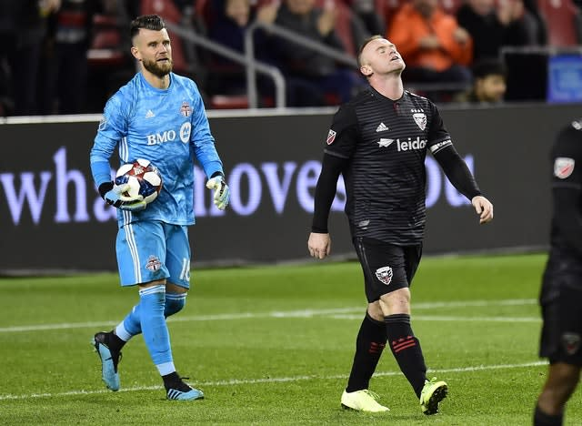 Wayne Rooney's (right) time in MLS ended on a low note as DC United were crushed 5-1 after extra time of their play-off against Toronto (Frank Gunn/AP)