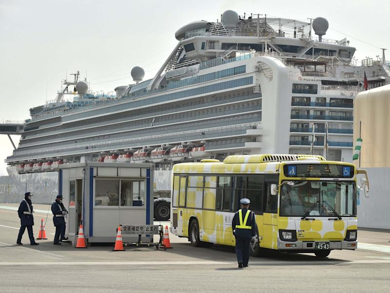 A bus carrying passengers who disembarked from the Diamond Princess cruise ship, which is in quarantine in Yokohama, Japan, following an outbreak of the new COVID-19 coronavirus, 20 February, 2020: Kazuhiro Nogi/AFP via Getty Images