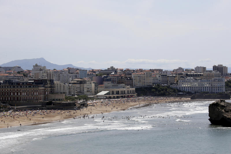 The beach of Biarritz, with G7 summit venues the Hotel du Palais, left, the Casino Municipal, center, and the Casino Bellevue, right, Wednesday, Aug. 21, 2019 in Biarritz, southwestern France. Leaders of the Group of Seven nations will meet Saturday for three days in the southwestern French resort town of Biarritz. France holds the 2019 presidency of the G-7, which besides the U.S. also includes Britain, Canada, Germany, Italy and Japan. (AP Photo/Bob Edme)