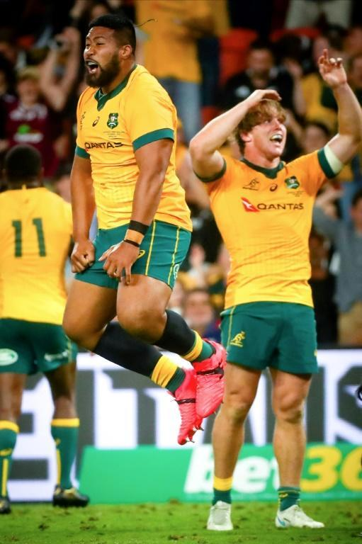 Australia's Folau Fainga'a (L) and Michael Hooper celebrate victory against New Zealand in the Tri-Nations and Bledisloe Cup rugby match in Brisbane on November 7, 2020.