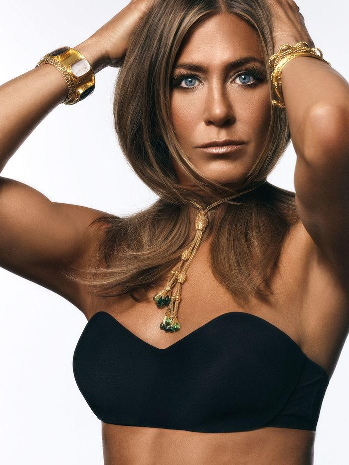 <p>Aniston in a DKNY bra, a&nbsp;Lalaounis necklace, Elizabeth Locke, John Hardy, and Reinstein Ross bracelets. Photographed by Michael Thompson.</p>