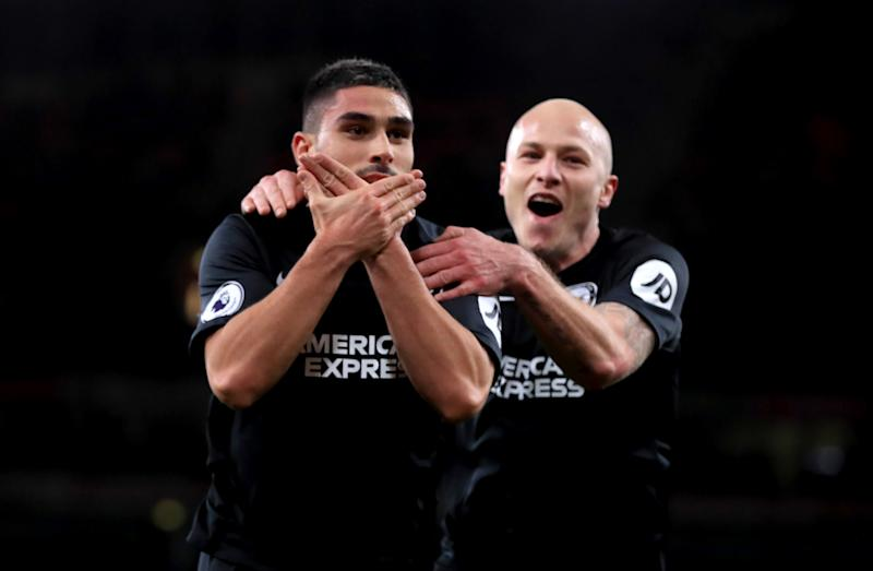 Brighton and Hove Albion's Neal Maupay (left) celebrates scoring his side's second goal of the game during the Premier League match at the Emirates Stadium, London. (Photo by Adam Davy/PA Images via Getty Images)