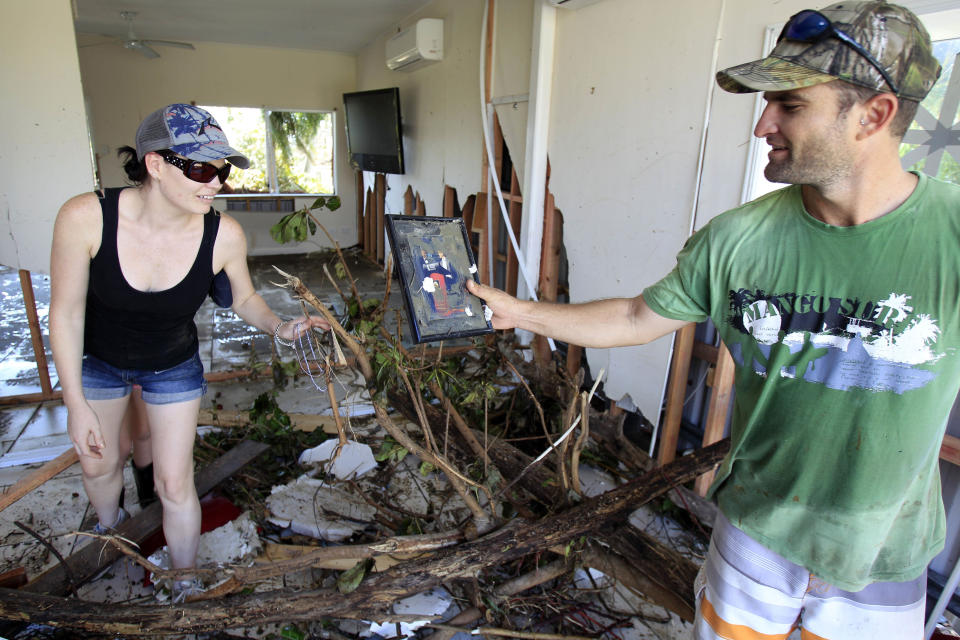 Couple find a photo found in the rubble of their home at Tully Heads, Queensland. Source: AAP