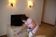 Woman disinfects inside a hotel room at Sunny Beach resort on the Black Sea