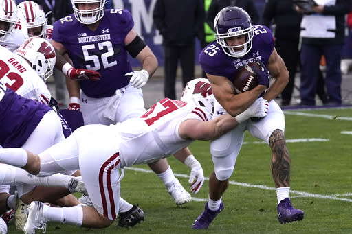 Northwestern running back Isaiah Bowser, right, is tackled by Wisconsin linebacker Jack Sanborn during the first half of an NCAA college football game in Evanston, Ill., Saturday, Nov. 21, 2020. (AP Photo/Nam Y. Huh)