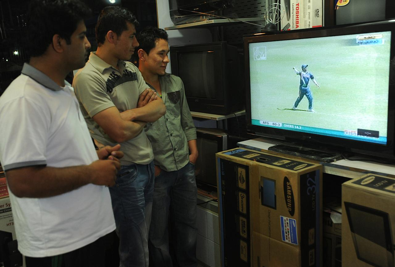 Afghan cricket fans watch a live broadcast of the World Twenty20 cricket match between Afghanistan and India played in Saint Lucia, at an electronics store in Kabul on May 1, 2010. Noor Ali made an even fifty as Afghanistan made 115 for eight off their 20 overs against India in the teams' World Twenty20 opener. AFP PHOTO/Massoud HOSSAINI (Photo credit should read MASSOUD HOSSAINI/AFP/Getty Images)