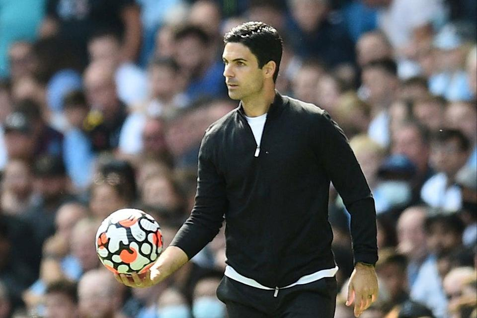 Mikel Arteta's Arsenal have lost all three of their Premier League matches this term  (AFP via Getty Images)