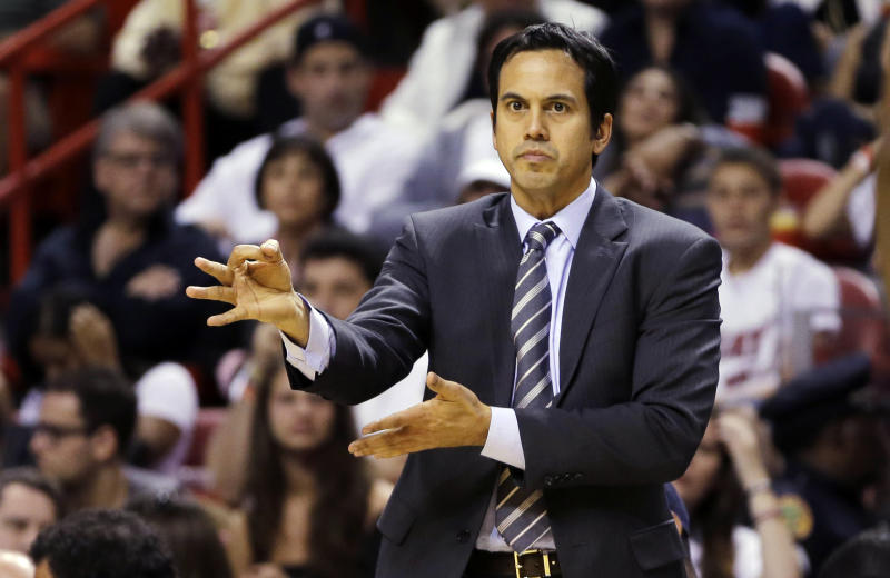 Miami Heat head coach Erik Spoelstra signals his team during the first half of an NBA basketball game against the Charlotte Bobcats in Miami, Sunday, March 24, 2013. (AP Photo/J Pat Carter)