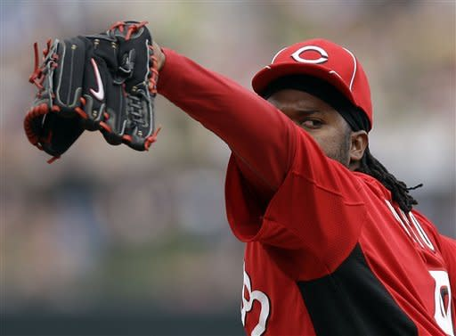 Cincinnati Reds starting pitcher Johnny Cueto throws to the Colorado Rockies during the third inning of a spring training baseball game on Sunday, March 25, 2012, in Scottsdale, Ariz. (AP Photo/Marcio Jose Sanchez)