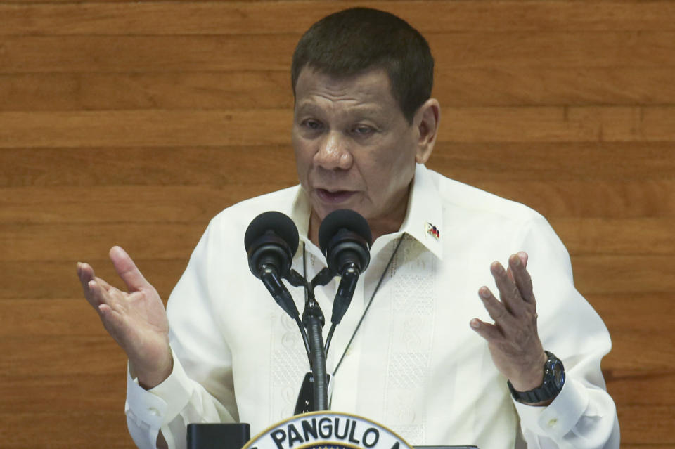 In this photo provided by the Malacanang Presidential Photographers Division, Philippine President Rodrigo Duterte gestures as he delivers his State of the Nation Address (SONA) at the House of Representative in Metro Manila, Philippines, Monday, July 27, 2020. (Simeon Celi Jr./Malacanang Presidential Photographers Division via AP)