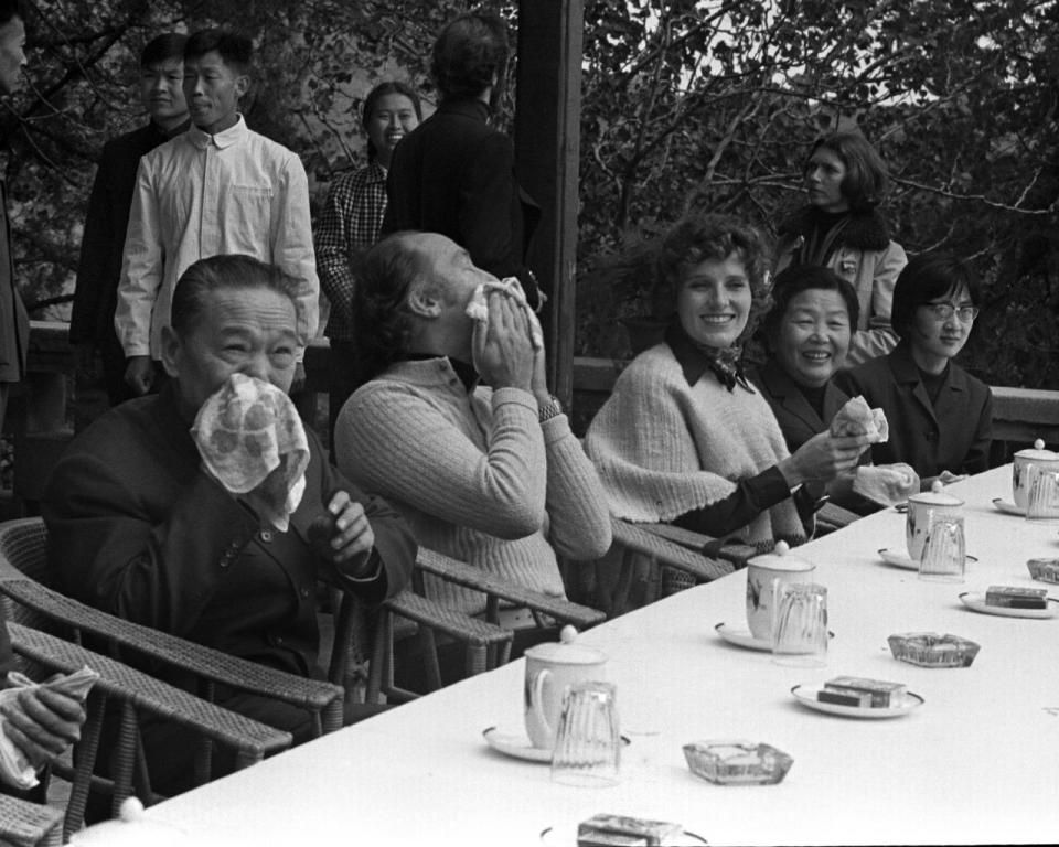 Former prime minister Pierre Trudeau feigns weariness while wiping his face prior to lunch at the Summer Palace near Fragrant Hills Park outside of Beijing, China, on Oct. 12, 1973. THE CANADIAN PRESS/PETER BREGG