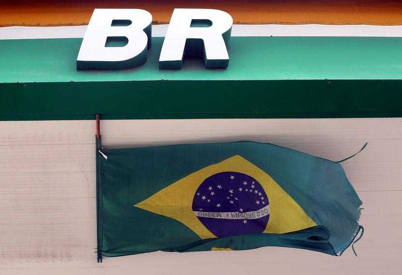 FILE PHOTO: The logo of Brazil's state-run oil company Petrobras is pictured next to a national flag at a gas station in Natal, Brazil November 19, 2018. REUTERS/Paulo Whitaker/File Photo