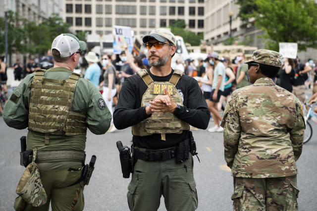 UNITED STATES - JUNE 06: Drug Enforcement Administration police are seen as demonstrators marched to Freedom Plaza from Capitol Hill to honor George Floyd and victims of racial injustice on Saturday, June 6, 2020. (Photo By Tom Williams/CQ-Roll Call, Inc via Getty Images)