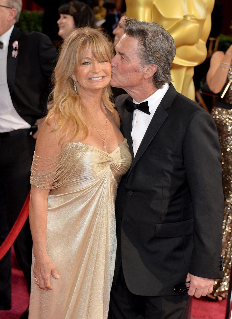 "<p>While Goldie Hawn and Kurt Russell aren't technically married, their happy and long-lasting relationship (35 years and counting) speaks for itself. <a href=""https://www.oprahmag.com/life/relationships-love/a25924942/goldie-hawn-kurt-russell-marriage/"" rel=""nofollow noopener"" target=""_blank"" data-ylk=""slk:The two met"" class=""link rapid-noclick-resp"">The two met</a> on-set of the 1966 Disney film <em>The One and Only, Genuine, Original Family Band</em>. However, it wasn't until 1983 when Russell won over Hawn on the set of <em>Swing Shift</em>.</p><p>""Look, I've said this for 34 years, I don't think Goldie and I, in real terms, are any different than any other couple; we go through all the same things,"" Russell said in a 2018 interview with <em><a href=""https://people.com/movies/goldie-hawn-kurt-russell-guardians-galaxy-premiere/"" rel=""nofollow noopener"" target=""_blank"" data-ylk=""slk:People"" class=""link rapid-noclick-resp"">People</a></em>. ""But the important thing of who the two people are in a relationship is what you have to deal with. There's gonna be ups and downs and sideways and everything else. I just think after 34 years you're gonna have experienced every emotion that you can together.""</p>"