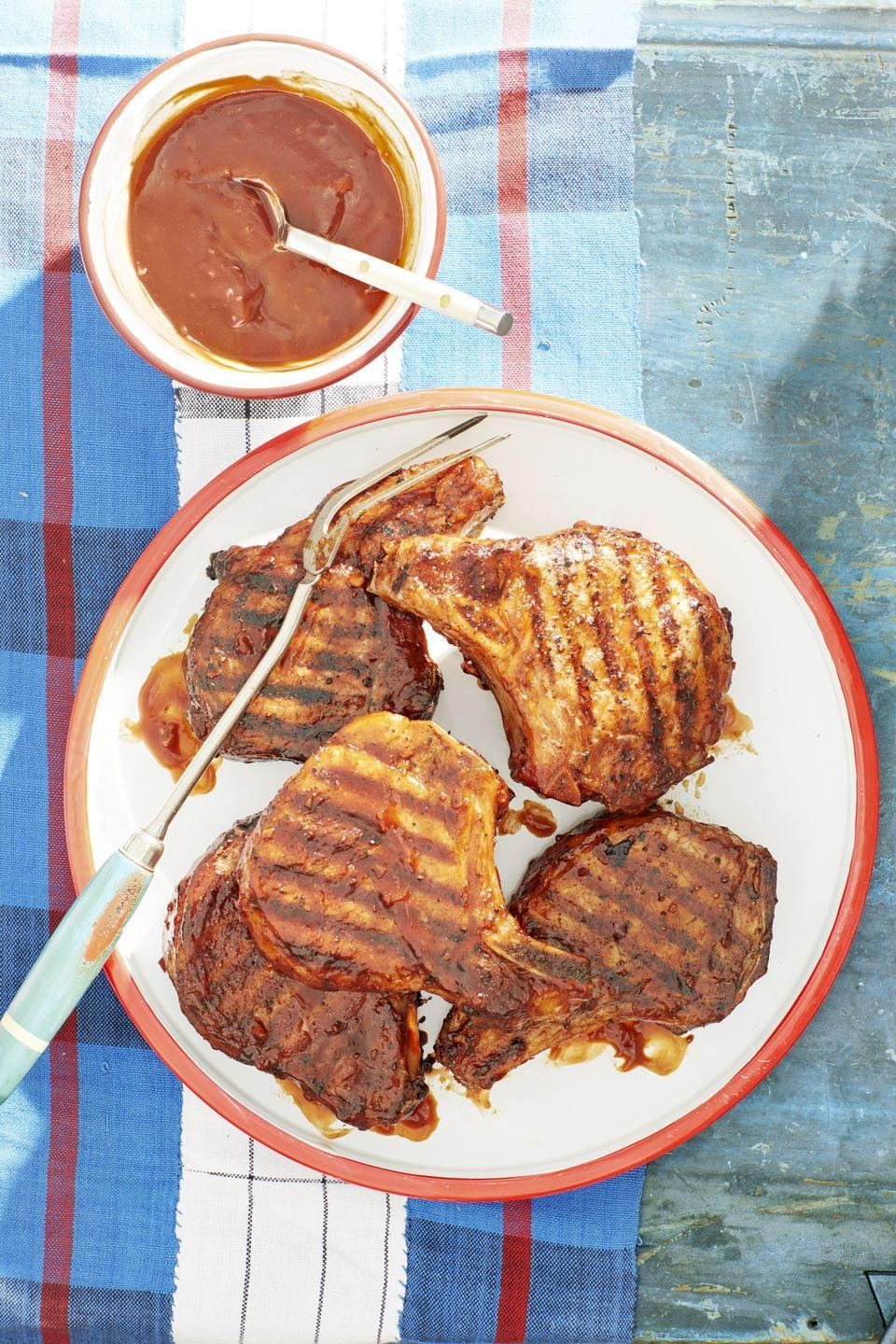 "<p>You might have to make a double—or even triple—batch of this whiskey-infused sauce. It's <em>that</em> good. </p><p><strong><a href=""https://www.countryliving.com/food-drinks/a21347095/bourbon-bbq-glazed-pork-chops-recipe/"" rel=""nofollow noopener"" target=""_blank"" data-ylk=""slk:Get the recipe."" class=""link rapid-noclick-resp"">Get the recipe.</a></strong></p><p><strong><a class=""link rapid-noclick-resp"" href=""https://www.amazon.com/Cuisinart-GR-4N-Griddler-Silver-Black/dp/B002YD99Y4?tag=syn-yahoo-20&ascsubtag=%5Bartid%7C10050.g.648%5Bsrc%7Cyahoo-us"" rel=""nofollow noopener"" target=""_blank"" data-ylk=""slk:SHOP GRILLS"">SHOP GRILLS</a><br></strong></p>"