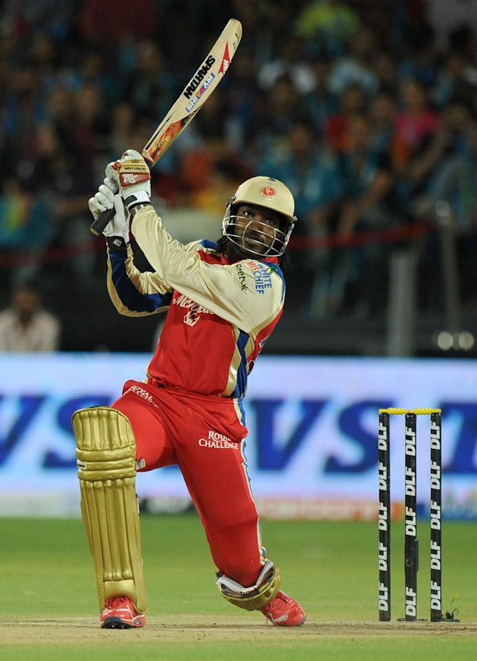 Royal Challengers Bangalore Chris Gayle plays a shot during the IPL Twenty20 cricket match between Pune Warriors India and Royal Challengers Bangalore at The Subroto Roy Sahara Stadium in Pune on May 11, 2012.  RESTRICTED TO EDITORIAL USE. MOBILE USE WITHIN NEWS PACKAGE    AFP PHOTO/Indranil MUKHERJEE        (Photo credit should read INDRANIL MUKHERJEE/AFP/GettyImages)