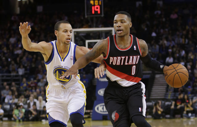 Portland Trail Blazers' Damian Lillard (0) dribbles next to Golden State Warriors' Stephen Curry during the first half of an NBA preseason basketball game on Thursday, Oct. 24, 2013, in Oakland, Calif. (AP Photo/Marcio Jose Sanchez)