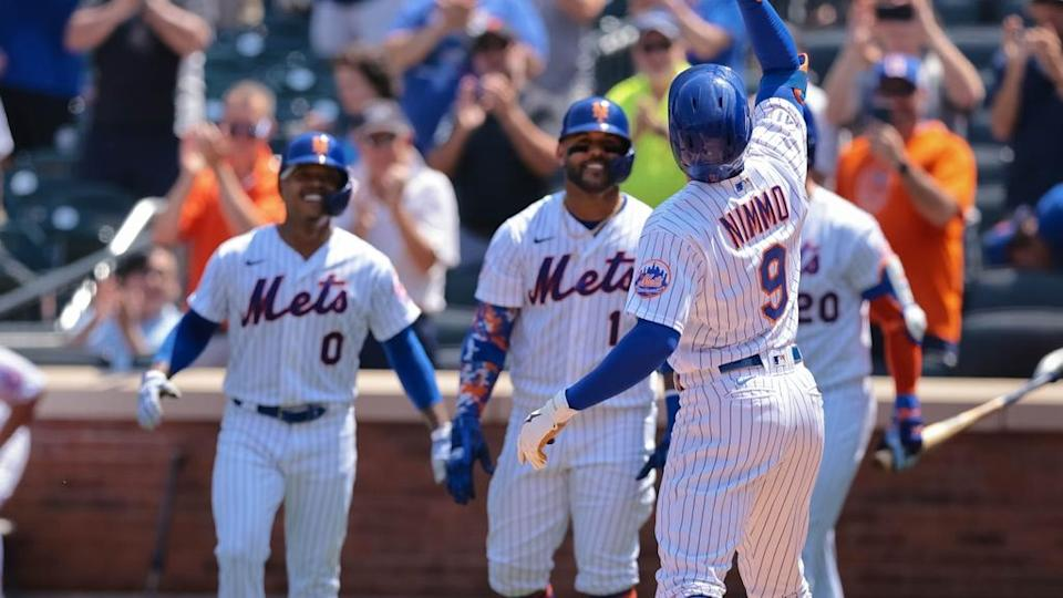 Aug 12, 2021; New York City, NY, USA; New York Mets center fielder Brandon Nimmo (9) celebrates with teammates after hitting a three run home run during the second inning against the Washington Nationals at Citi Field.