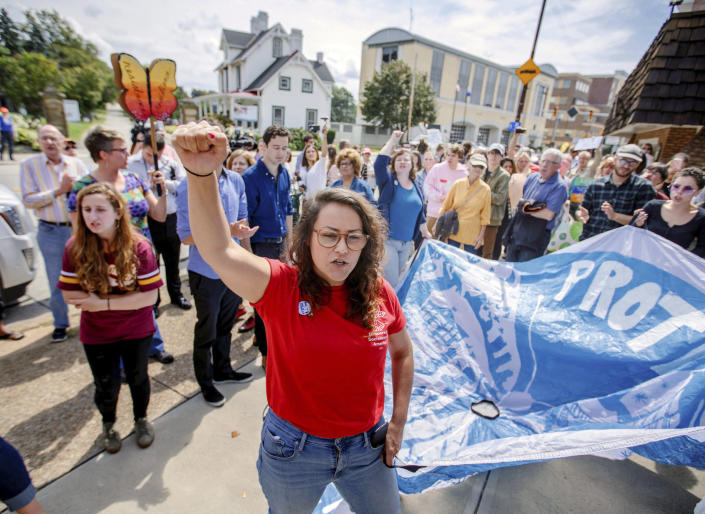 Arielle Cohen, co-chair of the Pittsburgh chapter of the Democratic Socialists of America, leads a chant outside the office of Rep. Tim Murphy, in response to President Trump's plan to end the Deferred Action for Childhood Arrivals program, Sept. 6, 2017. (Photo: Andrew Rush/Pittsburgh Post-Gazette via AP)