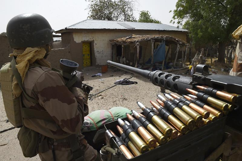 Niger troops patrol on April 3, 2015 in Malam Fatori, in northeastern Nigeria, which was retaken from Islamist Boko Haram militants by troops from neighbouring Chad and Niger