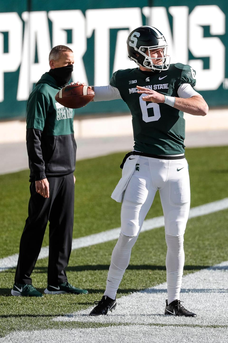 Michigan State quarterback Theo Day warms up ahead of the Indiana game at Spartan Stadium in East Lansing, Saturday, Nov. 14, 2020.