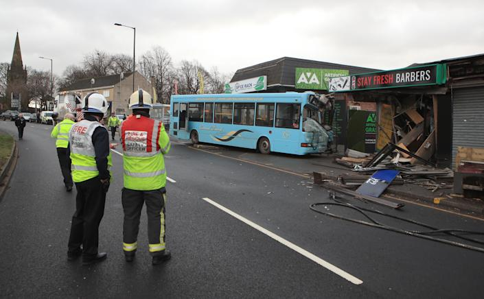 The scene in Handsworth Road, Sheffield, where a school bus crashed into the front of a barber shop. (PA)
