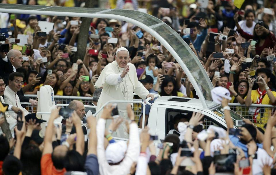 """<span class=""""caption"""">Young people at the University of Santo Tomas in Manila, Philippines, cheer Pope Francis in 2015, following his comments endorsing same-sex civil unions.</span> <span class=""""attribution""""><a class=""""link rapid-noclick-resp"""" href=""""https://newsroom.ap.org/detail/PopeCivilUnionsReaction/4ece31bccdf14e68bf0bdfa7e1a6baa0/photo?Query=pope%20civil%20union&mediaType=photo&sortBy=&dateRange=Anytime&totalCount=21&currentItemNo=2"""" rel=""""nofollow noopener"""" target=""""_blank"""" data-ylk=""""slk:AP Photo/Aaron Favila"""">AP Photo/Aaron Favila</a></span>"""
