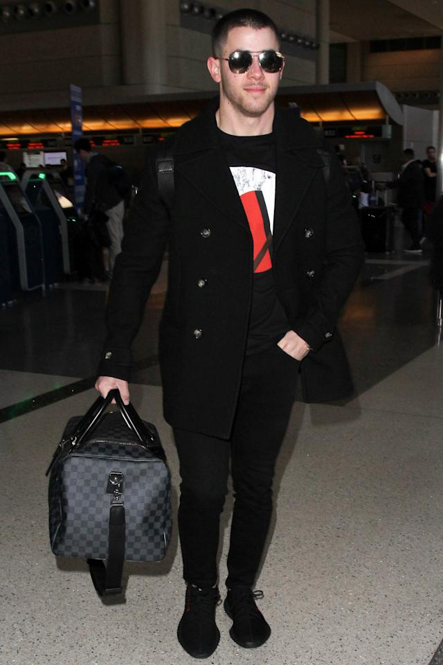 """<p>WHERE: Arriving at LAX in Los Angeles</p><p>WHEN: February 28, 2017</p><p>WHY: The keys to excellent airport style: simple layers, cozy kicks, and <a rel=""""nofollow"""" href=""""http://www.gq.com/story/best-leather-duffel-bags?mbid=synd_yahoostyle"""">one baller duffel bag</a>.</p>"""