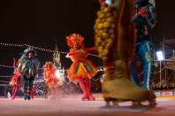 Skaters perform during the opening of an outdoor skating rink in the Red Square in Moscow