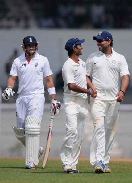 MUMBAI, INDIA - NOVEMBER 01:  Yuvraj Singh (R) of India 'A'  is congratulated by teammate Ashok Dinda as the prior claims the wicket of Tim Bresnen (L) as they walk back to the pavilion after the end of  second innings during the final day of the first practice match between England and India 'A' at the CCI (Cricket Club of India) ground, on November 1, 2012 in Mumbai, India.  (Photo by Pal Pillai/Getty Images)
