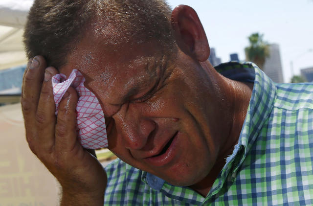 <p>Steve Smith wipes sweat from his face as temperatures climb to near-record highs in Phoenix on June 19, 2017. (Ross D. Franklin/AP) </p>