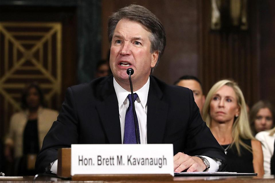"<p>Supreme Court nominee Brett Kavanaugh faces the Senate Judiciary Committee in September 2018.</p> <p>During his tenure, Trump appointed three conservative Supreme Court justices to take seats vacated by Antonin Scalia, Anthony Kennedy and Ruth Bader Ginsburg. Nominee Kavanaugh, Trump's second appointee, faced intense scrutiny from the Senate Judiciary Committee after accusations of sexual misconduct surfaced from high school acquaintance Christine Blasey Ford. Ford <a href=""https://people.com/politics/christine-blasey-ford-brett-kavanaugh-testify-sexual-assault-allegations/"" rel=""nofollow noopener"" target=""_blank"" data-ylk=""slk:testified against"" class=""link rapid-noclick-resp"">testified against</a> Kavanaugh — <a href=""https://people.com/politics/christine-blasey-ford-brett-kavanaugh-testimony-death-threats-cant-go-home/"" rel=""nofollow noopener"" target=""_blank"" data-ylk=""slk:despite threats"" class=""link rapid-noclick-resp"">despite threats</a> to her safety for doing so — but ultimately, <a href=""https://people.com/politics/brett-kavanaugh-confirmed-supreme-court-sexual-assault-allegations-vote/"" rel=""nofollow noopener"" target=""_blank"" data-ylk=""slk:Kavanaugh was confirmed"" class=""link rapid-noclick-resp"">Kavanaugh was confirmed</a> by an exceptionally narrow Senate margin.</p>"