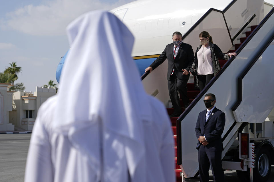 U.S. Secretary of State Mike Pompeo and his wife Susan step off a plane at Old Doha International Airport, Saturday, Nov. 21, 2020, in Doha, Qatar. (AP Photo/Patrick Semansky, Pool)