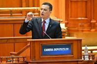 Romania ruling left sinks own govt after power row